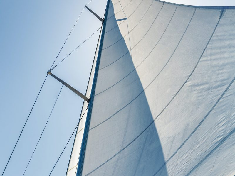 Sail on sky background